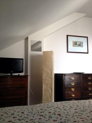 stanza attico